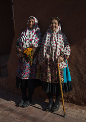 Iranian women wearing traditional floreal chadors in zoroastrian village, Natanz county, Abyaneh, Iran (Eric Lafforgue) Tags: 2people 60sadult abiyaneh abyaneh adultsonly aging chador clothes clothing colorimage covered dress elderly female floreal flowers fulllength headscarf iran iranian islam lookingatcamera middleeast muslim natanzcounty outdoors people persia portrait redvillage shia shiite tourism touristic tradition traditional traditionalclothing twopeople veil vertical village wearing women womenonly ir