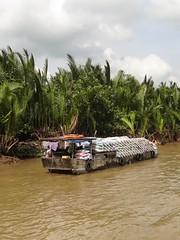 IMG_3355 (program monkey) Tags: mekong delta vietnam river boat cargo loaded bags ben tre tra vinh