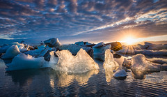 Burning Icebergs (hpd-fotografy) Tags: travel blue sunset sky seascape cold ice nature water clouds outdoors is iceland nikon scenic atmosphere lagoon glacier arctic nordic iceberg ultrawide jokulsarlon goldencircle sandinavia bestawarddistributors