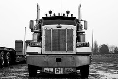 peternose (Burnt Out Chevrolet) Tags: uk winter wild england bw white black cold wet wheel truck painting puddle island grey mono design blackwhite drawing circus uncle chief sony united traditional north gray over kingdom overcast 11 tent grill semi lincolnshire east chrome american february feb alpha a200 pleasure bnw exposed sams bleached gravel cleethorpes exhaust chromatic peterbilt nel 2011 lincs humberston