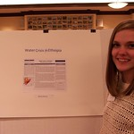 A student posing with her research on the water crisis in Ethiopia.