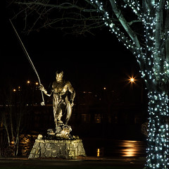 Tom McCall Memorial statue (docoverachiever) Tags: light reflection water statue bronze night oregon lights fisherman christmaslights salem riverfrontpark lighted flickrchallengegroup governortommccall