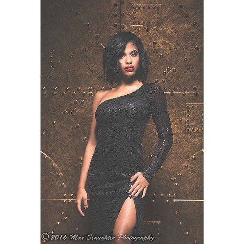 This bewitching beauty wearing black is Regina and she is truly bewitching in this glittery formal dress.