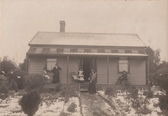 Dad loves a lark after snowfall! (c.1915) (pellethepoet) Tags: photograph australia snow cottage house frontgarden family garden verandah porch children girls