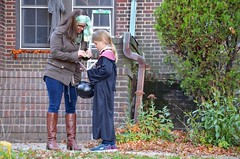 Checking Lily's Candy (Joe Shlabotnik) Tags: sarahp 2016 october2016 halloween lily afsdxvrzoomnikkor18105mmf3556ged faved