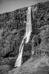 the stunning beauty of Bjarnarfoss waterfall (lunaryuna) Tags: iceland westiceland snaefellsnespeninsula landscape rockface cliff columnarbasalt bjarnarfoss waterfall blackwhite bw monochrome textures nature beauty lunaryuna bjarnafoss