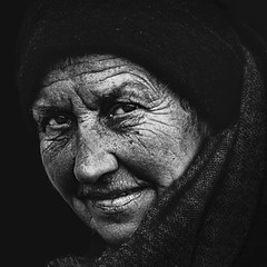 A little smile on homeless woman face (Ales Dusa) Tags: woman homeless smile face emotions canon5d wrinkledwoman streetportrait streetshot oldlady