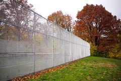 L1000416_p (thebiblioholic) Tags: setonpark riverdale bronx fence fallcolors tenniscourt