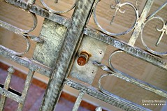 Safety Lines... (dimitra_milaiou) Tags: door summer white color detail texture love lines metal wall architecture yard 35mm fence walking island photography nikon rust europe closed moments colours outdoor lock d visit greece f repair fixing lovely tradition 18 shape pure 90 chora andros cyclades pant dimitra 2015 d90     milaiou