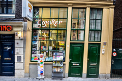 Gojoker comics - Amsterdam, Netherlands. (Andrea Daidone) Tags: world road new city blue winter friends sky people urban bw panorama streets travelling history love netherlands amsterdam vertical shop night season walking town photo big high amazing nikon day colours view shot nightout cloudy patterns exploring horizon citylife culture center palace panoramic explore fantasy journey thinking classics around important gulp coutry