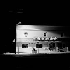 End of Season (colinpoe) Tags: night nightime blackandwhite rolleiflex manualexposure mediumformat 6x6 rodinal150 street beachhaven storefront shadows lbi longexposure rolleiflexautomat signage sign tlr rodinal naturallight deserted trix400 bw signs trix 120