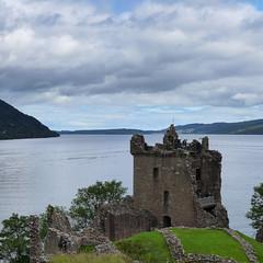 Battle side at the Loch (rimerbl) Tags: lochness urquhartcastle scotland leicadlux6 dlux6 thehighlands loch lake water clouds sky castle ruin unitedkingdom hillside hills