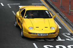 "Porsche, 928, ""Autolook body kit"", Causeway Bay, Hong Kong (Daryl Chapman Photography) Tags: du2133 porsche german 928 cwb causewaybay 1d mkiv yellow car cars auto autos automobile canon eos is ii 70200l f28 road engine power nice wheels rims hongkong china sar drive drivers driving fast grip photoshop cs6 windows darylchapman automotive photography hk hkg bhp horsepower brakes gas fuel petrol topgear headlights worldcars daryl chapman darylchapmanphotography"