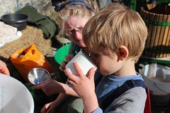 Child drinking freshly pressed apple juice (Local Food Initiative) Tags: permaculture apple day apples press pressing cider group sustainable orchard drink juice joy tasty drinking