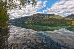 Reflecting on Muncho Lake (Philip Kuntz) Tags: muncholake reflections clouds alcanhighway alongthealcanhighway lakes pristinewaters copperoxide britishcolumbia canada