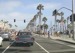 Oldsmobile we followed through Huntington Beach, CA (EllenJo) Tags: california ca vacation vintagecar convertible pch highway1 hotrod huntingtonbeach oldsmobile cutlass surfcity pacificcoasthighway madeindetroit ellenjo summerincalifornia ellenjoroberts triptocatalinaisland august2015 blackolds