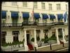 The Rose Garden Hotel London (Audrey A Jackson) Tags: door city flowers windows london architecture hotel doors capital flags redcarpet canopies therose panasonicdmctz3