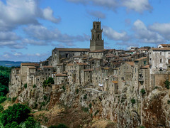 pitigliano. (lucafabbricesena very busy) Tags: italy cloud building tower history rock architecture village hill medieval tuscany clinging tufo paese pitigliano greatphotographers tufe greatestphotographers