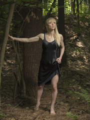 Lost? (Pennant) Tags: lingerie satin vintage slip blonde bangs forest nature green woman black shine shadow light babe bare feet toes upskirt woods tree leave long short
