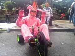 Big Wheel Race 2013: Pink Bunny Man on Bike (Lynn Friedman) Tags: sanfrancisco ca usa silly race easter fun toy costume sunday humor competition event friendly annual bigwheel potrerohill crookedstreet lucky13 94109 eastersunday march31 onlyinsanfrancisco rainorshine 94107 2013 vermontst byobw bringyourownbigwheels bringyourownbigwheel bringyourown lynnfriedman bigwheelsrace bwr2013 httpbringyourownbigwheelcom bringyourownbigwheelcom