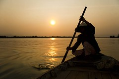 Old Lady Rowing in Hoi An Harbour at Sunset, Vietnam (sredzic17) Tags: old sunset sky people orange woman silhouette yellow horizontal female port asian person photography one 1 evening boat photo asia southeastasia vietnamese adult image dusk stock streetphotography unescoworldheritagesite unesco worldheritagesite vietnam hoian silhouetted rm oldharbour rowingboat travelphotography nighttimephotography rightsmanaged centralvietnam thubonriver stocktravelphotos