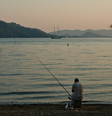 sunset waters (rafartreides2016) Tags: turkey fisherman gcek clichsaturday