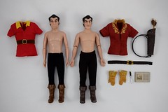 Deluxe vs Designer Gaston 12 Inch Dolls - Bodies and Outfits - Lying Down - Full Front View (drj1828) Tags: us disneystore dfdc heroesandvillains disneyfairytaledesignercollection 2016 gaston purchase deboxed deluxedollgiftset beautyandthebeast comparison undressed outfits