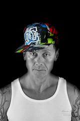 Unbenannt-141 (alexander.dischoe) Tags: shooting indoor licht light tanktop male mann asia cap teiltonung nikon nikond7100 nikon18200mm nikkor18200mm dslr spiegelreflex tattoo tätowierung gesicht portrait porträt face arc
