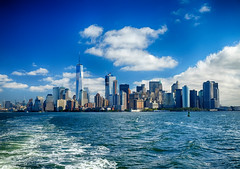 New York City skyline (` Toshio ') Tags: toshio nyc newyorkcity newyork manhattan city skyline bay hudsonriver eastriver boat oneworldtradecenter clouds usa america fujixe2 xe2