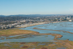 San Carlos Airport (Disorderly) Tags: sanfranciscobay aviation corrugated aluminum sancarlos california flying flight aloft airport airfield runway marsh swamp bay water