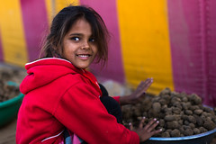 Desert Beauty (Karunyaraj) Tags: beauty smile cameldung cameldungcollector red tent cute cuteness cuteexpression cutelook cuteeyes india indian desert desertgirl littleworker look nikond610 sigma5014art sigma50mm cwc chennaiweekendclickers cwc561