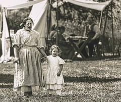 Woman and Child (Wes Iversen) Tags: civilwardays hbmt michigan monochromebokehthursday portsanilac tamron150600mm children costumes men monochromeblackwhite people tents vintage women