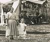 Woman and Child (Wes Iversen) Tags: civilwardays hbmt michigan monochromebokehthursday portsanilac tamron150600mm children costumes men monochromeblackwhite people tents vintage women