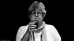 Cappuccino (Neil. Moralee) Tags: dunsterneilmoralee neilmoralee woman mature alone solo portrait coffee glasses drinking scarf cappuccino ital italian dunstaer uk close dark blackbackground cup righthand lady female large big nikon d7100 neil moralee bw blackandwhite black white mono monochrome hot steaming candid dunster castle somerset 18300mm zoom