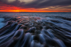 Against All Odds (David Colombo Photography) Tags: hospitalsreef lajolla potholes sunset pacific ocean reef rocks water sun clouds orange purple blue landscape seascape nikon d800 davidcolombo davidcolombophotography outdoor storm hightide bigwaves waves sandiego california fineart photography