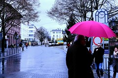 From Sunny Cape Town to Wet and Wintry Bad Homburg! (Raphael de Kadt) Tags: badhomburg germany umbrella louisenstrasse wetandwintry streetphotography eveninglight
