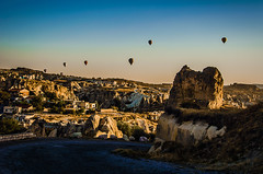 Winding (Melissa Maples) Tags: ortahisar turkey trkiye asia  nikon d5100   nikkor afs 18200mm f3556g 18200mmf3556g vr kapadokya cappadocia autumn dawn morning hotairballoons balloons rockformation rockformations stone fairychimneys road