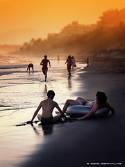 Someones Somewhere In Summertime (servalpe) Tags: sunset sea summer people seascape beach water canon fun outdoors person andalucía spain sand funny time shoreline playa shore topless summertime es canonixus400 marbella fontanilla servalpe playadelafontanilla