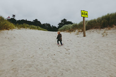 60A (greghanover) Tags: beach nature girl sign oregon climb coast sand solitude alone outdoor dunes ella windy pacificocean journey newport pacificnorthwest conquer muted discover 60a