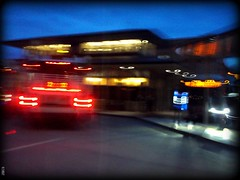 Morning Motion (~nevikk~) Tags: headlights colorfullights taillights beforesunrise fluorescentlights earlymorningactivity busseslinedup stcloudbusterminal kevinekelly