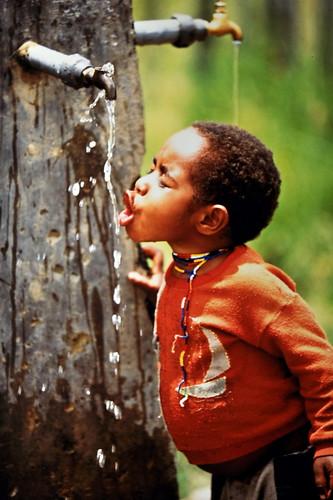 Western New Guinea - Baliem Valley - Dani Boy Drinking Water