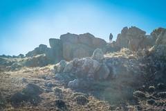 Amanda climbs some rocks to get a better view.