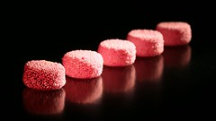 5 sweets in a row (HansHolt) Tags: pink macro reflection rose canon dof candy drop row 100mm licorice hmm allsorts roze anise 6d engelsedrop weerspiegeling reflectie rij snoep liquoriceallsorts aniseed allinarow licoriceallsorts spogs canonef100mmf28macrousm horsecake anijs macromondays canoneos6d anijszaad liquroce