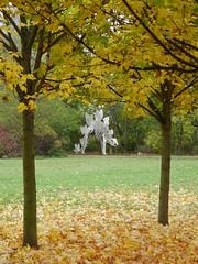 Stegosaurus autumn (Nekoglyph) Tags: autumn trees sculpture green leaves metal golden dinosaur steel stegosaurus teesside teessauruspark