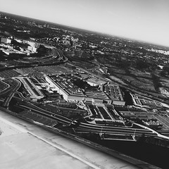 354/365 {Explored 12/22/2015} (moke076) Tags: trip travel sky bw building oneaday mobile plane flying flickr unitedstates wing cellphone cell explore photoaday government 365 shape pentagon windowseat throughthewindow iphone project365 explored 365project vsco vscocam