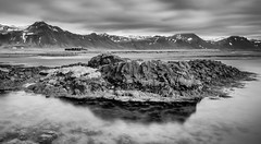 Lonely Places (John Fÿn Photography) Tags: 10stops longexposure neutraldensityfilter slowshutterspeed 24mmpce 24mmtiltshiftlens bw blackandwhite d810 filter gray grey iceland landscape leebigstopper manfrottotripod mono monochrome ndfilter nordic nikon nikonfx republicoficeland sea water alps cloud crag elevation foothills hill house mountain mountainrange outdoor peak perspectivecorrection range ridge rock tiltshift vast west is