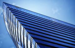 perspective (Marcus Rahm) Tags: wien vienna austria sterreich gebude haus hochhaus tower building architektur architecture blue window windows wolken clouds mirror spiegelung spiegeln donau donaukanal travel schwedenplatz raiffeisenhaus passivbrohochhaus