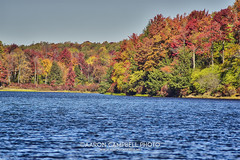 Across the Lake II, 2016.10.14 (Aaron Glenn Campbell) Tags: rgsp rickettsglen statepark lakejean redrock pennsylvania autumn fall foliage colorful outdoors dcnr lake water boat dock 3xp â±2ev hdr macphun aurorahdrpro sony a6000 ilce6000 sonyalpha6000 mirrorless fotodiox lensadapter canon fd200mmf4 telephoto primelens manualfocus emount