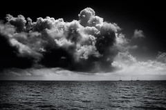 Cloudy with a chance of thunderstorm (azhukau) Tags: clouds cloudy ocean ses seascape boat dramatic monochrome blackandwhite giant thunderstorm forecast lowkey