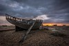 Walking the plank (James Waghorn) Tags: sigma1020f456 autumn beach net dungeness sunset pebbles boat wreck kent d7100 clouds england plank bleak solitude alone